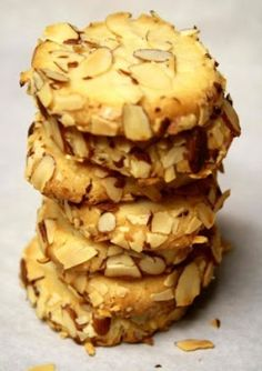 Cream Cheese Almond Cookie - I've never added cream cheese to any sort of cookies before! These look great and I love that they're rolled in almonds!
