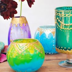 Simply add paint to old glass jars and transform them into beautiful Moroccan lanterns!  (easy tutorial)