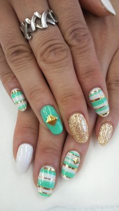 Green/teal, gold, and white nails. #manicure #glitter #summer #spring #stripes #glamourgrail