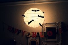 Add rubber bats to a paper lantern for an easy but creepy DIY Halloween project. See all our paper lanterns here: http://bit.ly/1uh6YiH #paperlantern #halloweendecor #diy halloween decorations, halloween parties, chinese lanterns, paper, halloween party ideas, halloween crafts, bat, cut outs, halloween diy