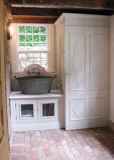 Love this!  Metal sink, brick floors and wooden beams. Great idea for mud room out to back yard (for washing up after dirty outdoor chores/play).