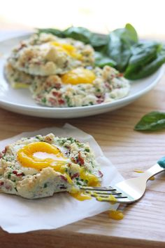 Eggs in clouds make a great, low calorie breakfast with fluffy egg whites baked with crumbled bacon, chives and Parmesan cheese and a nestle...