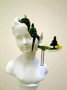 Mixed media artist Gregory Grozos deconstructs a sculptural bust, transforming it into a secret garden for miniature figures.  via My Modern Metropolis