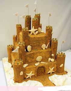 Sand castle themed birthday party but add dump trucks cars etc to boy it up less shells