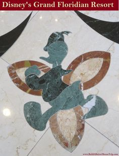 Donald Duck inlay in the marble floor in the lobby at Disney's Grand Floridian Resort.  For more resort photos, see: http://www.buildabettermousetrip.com/disneys-grand-floridian   #DonaldDuck #GrandFloridian #Disneyworld #WDW