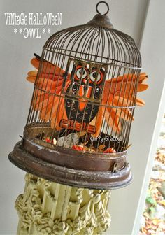 Vintage crepe paper winged owl in a birdcage