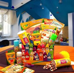 colorful gift basket for kid. crayons, coloring book, bubbles, pez, jelly belly, tootsie rolls, gum balls, skittles, etc.