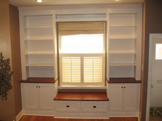 built in around window with bench seat (create toy storage in bench, to put toys away)