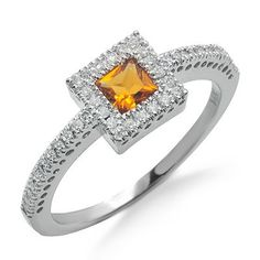 A beautiful 1/3 carat gold citrine gemstone sits bezel set in the center of this 14k white gold ring. The citrine is surrounded and accented by round prong set diamonds. The diamonds have G/H color and SI2/SI3 clarity.Different ring sizes may be available. Please inquire for details. $372.00