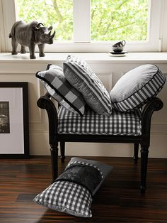 Black and white pillows - check bench - rhino