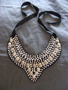 Jackie- Same concept just in a leaf pattern with beads to match your dress.   diy collar necklace gold beads black leather tutorial