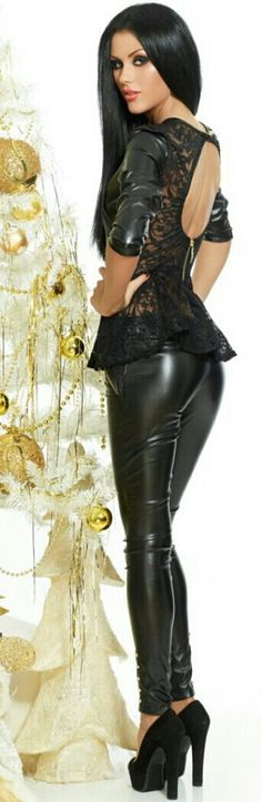 Beautiful model in latex pants and armed top so want to see Nikki Groff in this