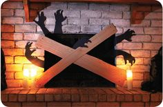 Zombie silhouettes behind a boarded fireplace.