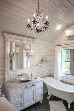 Love the shiplap, the claw foot tub, the sink, mirror!
