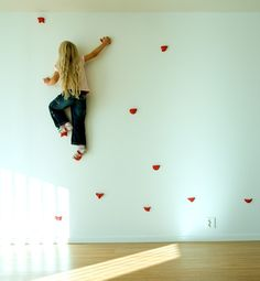 Who says staying at home can't be an adventure? Wall art becomes functional with these rock-climbing mounts in a Swedish home by Saunders Architecture. The red color adds extra punch and can get the entire family involved.ON REMODELISTA: Outdoors Children's Swings