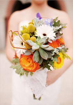 Gerbera Daisy + succulents + orange rose.