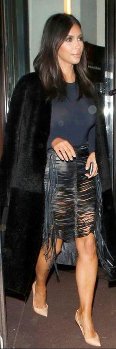 Kim Kardashian: Skirt – Madga Butrym  Shirt – Woldford  Coat – Calvin Klein