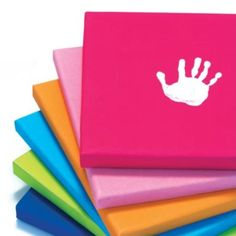 white handprints on colorful canvas. be cute to do one every year