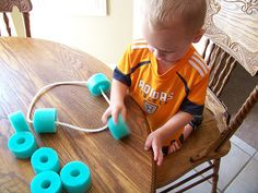 Pool noodle stringing busy bag. Easy and perfect for a toddler!