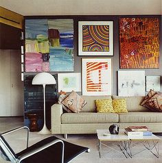 I love the idea of taking up every inch of a wall with art.