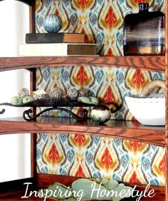 Add style to a bookshelf or hutch by backing it with your favorite fabric! How to easily and inexpensively achieve this look without destroying the wood on the shelf!