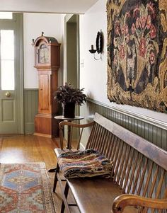 A Deacons Bench and Antique Rugs.
