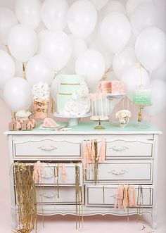 dessert table with white balloons