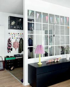 I love the window wall dividing the entryway from the living room.