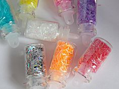 Hey, I found this really awesome Etsy listing at https://www.etsy.com/listing/159525502/eight-miniature-glass-bottles-of