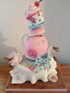 This cake would be perfect for a special lady... How do they get it to balance like that? Wouldn't you be afraid to move it?