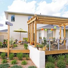 Create Modern Style--This ordinary builder's deck created usable space, but no style. The homeowners added a sweeping perimeter curve and metal accents to create a backyard haven.