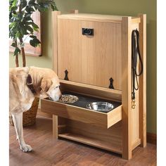 The Dog Butler - a spot for food, leashes, etc. I need one of these.
