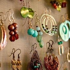 DIY earring organizer - Straighten up your pile of jewelry and show off your collection at the same time! hanger, earring holders, a frame, diy jewelry, old frames, picture frames, earring organ, screen doors, diy earrings