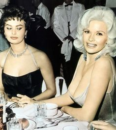1957. Romanoff's in LA. Jayne Mansfield  upstages the party to officially welcome Sophia Loren to Hollywood. http://scattergood-blog.blogspot.com/2009/08/jayne-mansfield-and-sophia-loren.html