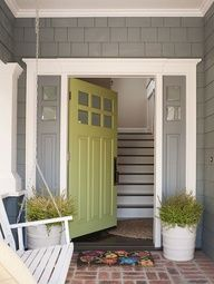Grey house + white trim + lime-y door + greenery planters