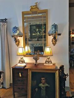 via LissyParker blog: Charles Faudree Estate sale | Classic symmetry at work on this wall