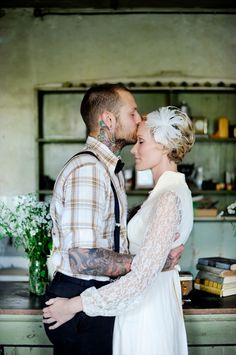 beautiful photo.  short hair bride, groom with tattoos. love it all! via ruffled, photo by squaresville studios.