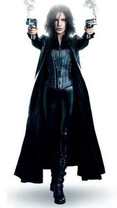 """$299.00 - This Black Kate Beckinsale Leather Jacket is worn by Selene in """"Underworld: Awakening"""" Movie 2012. This Long Coat Underworld Awakening jackets is sold in real leather."""