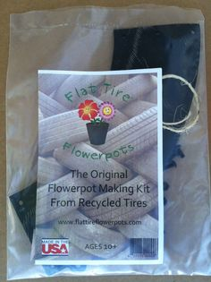 Flowerpot kit made out of recycled tires!   Companies purchase kits at wholesale to donate to schools to learn about recycling and gardening!  www.flattireflowerpots.com
