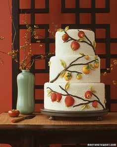 Modern Wedding Cakes  Asian Wedding Cake    Designs from Asian ceramics inspired the gum-paste pomegranates and persimmons that adorn a fondant-covered cake.    Read more at Marthastewartweddings.com: Wedding Cakes by Style -- Martha Stewart Weddings