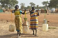 Young women spend their days looking for water, Jamam refugee camp, South Sudan by Oxfam International, via Flickr