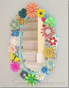 Vintage enamel flower pins on mirror. This would be so cute in a little girls room.