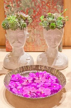 For a minimalist arrangement, float hot pink orchids in a textured silver bowl.