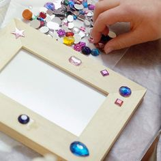 """Picture Frame Bling: Even the smallest fingers can do this with just a little bit of help. Perfect for a """"craft day"""" when it's chilly outside. You could also use this simple project for a birthday party idea. This gives the kiddos something fun to do and an instant homemade take home gift!"""