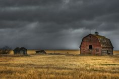 Old red barn on the prairies of Canada.