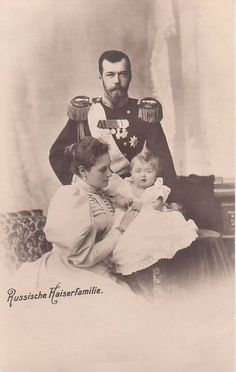 Baby Olga with her mother and father.