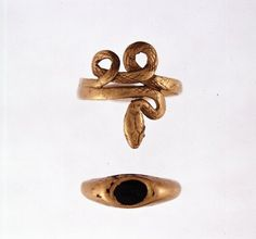 Gold Finger Rings  Roman  1st/2nd Century AD  Gold finger-ring; in the form of a serpent coiled in a spiral; in one of the eyes is a small emerald.