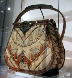 "1820-1850 Mi'kmaq (First Nations) Purse at the Royal Ontario Museum, Toronto - From the curators' comments: ""Mi'kmaq people have been decorating birchbark with porcupine qullls since the 18th century and perhaps even earlier. Their Malecite neighbours called them the ""Porcupine People"". Such work was developed almost entirely for sale or trade and was an important source of income for Mi'kmaq families..."""