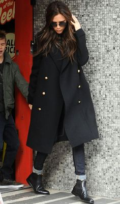 #AutumnFashion - VB knows how! Chelsea boots, glossy hair and an oversized military style coat make her look edgy but effortlessly glamorous.