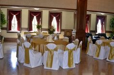 white and gold, but the gold chair coverings need to be tied differently